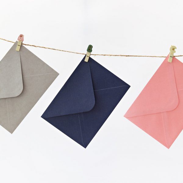 Envelope hanging on string