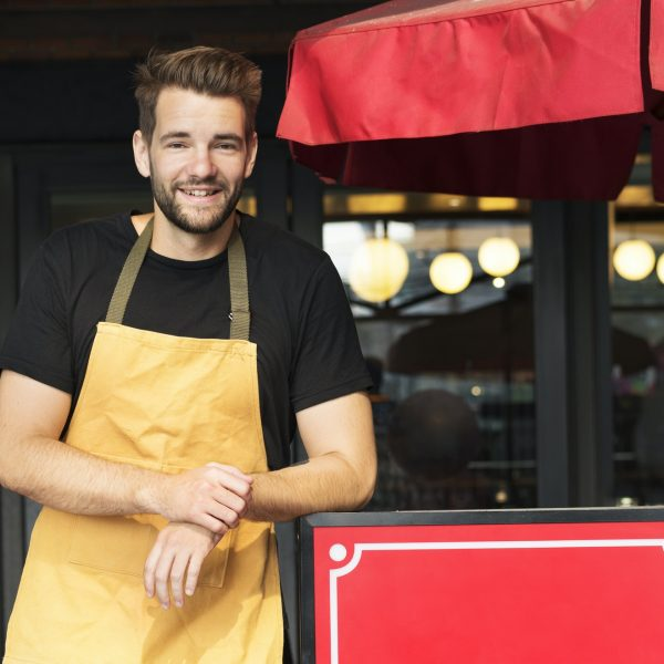 Small business owner standing infront of restaurant